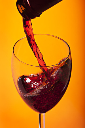 pours wine on a bright background