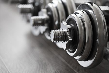 heavy weight: sports dumbbells Stock Photo
