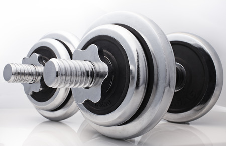 dumbbell close up on a white background