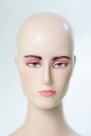 Beautiful plastic mannequin head, which is usually used for shop display photo