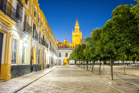 The Giralda bell tower lit up at night in Seville, Spain, Europe Stock Photo