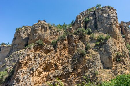 A gorge in the city of Ronda Spain, Europe on a hot summer day with clear blue skies Stock Photo