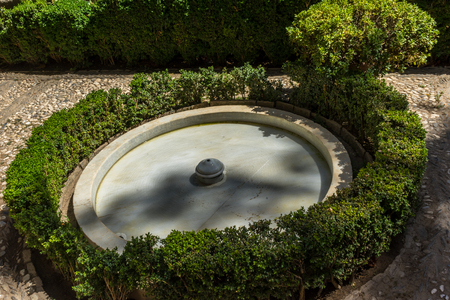 Cool Water fountain in the Alhambra in Granada, Spain, Europe on a bright sunny day