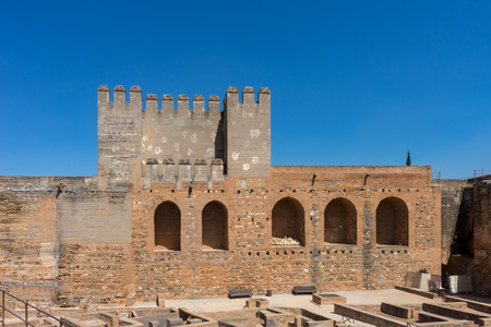 Alcazaba, Ruins of former ancient fortress Alhambra.Military house, Granada, Andalusia, Spain, Europe on a bright sunny day with clear blue skiy Stock Photo