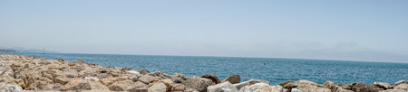 Panoramic view of the ocean at Malagueta beach with rocks at Malaga, Spain, Europe on a clear sky morning