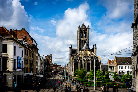 A view of the Saint Nicholas Church, Ghent, Belgium on a bright summer day with blue sky Editorial