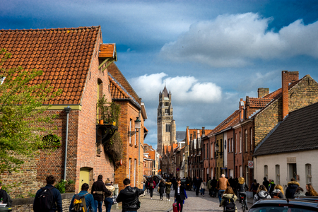 Bruge, Belgium - April 17 : Tourists walk towards the St. Salvators Cathedral June 17, 2017 on a cloudy day during