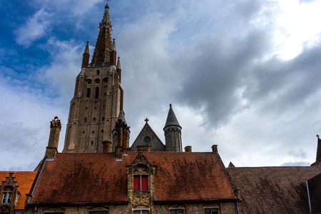 The Tower of the Church of our lady in Brugge, Belgium, Europe with a blue sky Stock Photo