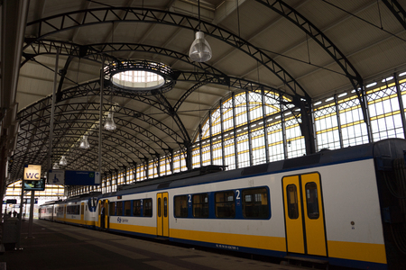Den Haag, Netherlands - April 14 :  the glass decoration at the Den Haad Holland Spoor railway station, Den Haag HS, Netherlands on April 14, 2017 on a bright summer day.