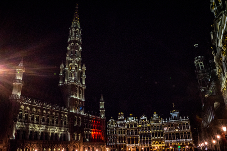 The townhall and belfry tower of Brussels is illuminated and lit up at night, Belgium, Europe Editorial