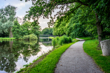 walking path along a pond at Haagse Bos, forest in The Hague, Netherlands, Europe Stock Photo