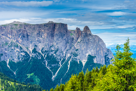 Italy, Alpe di Siusi, Seiser Alm with Sassolungo Langkofel Dolomite, a canyon with Yosemite National Park in the background