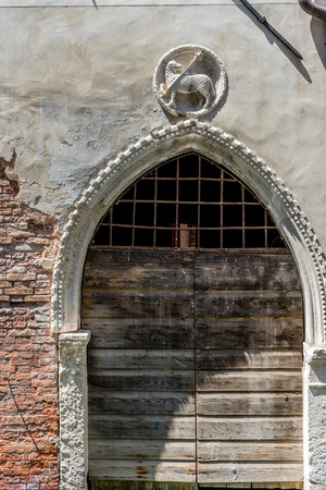 Europe, Italy, Venice, a stone building that has a bench in front of a brick wall 写真素材