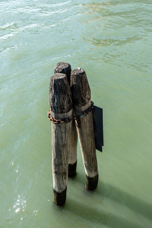 Italy, Venice, a wooden pole in body of water