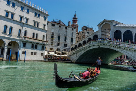 Venice, Italy - 01 July 2018: The Rialto bridge over the grand canal in Venice, Italy