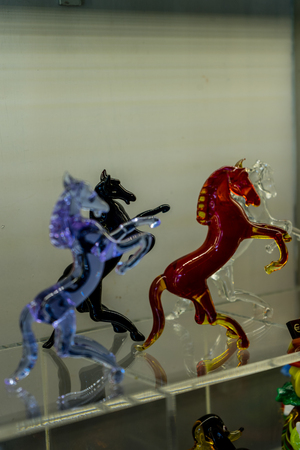 Venice, Italy - 01 July 2018: glass artifacts on display in a shop in Venice, Italy prancing horse