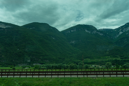 Europe, Italy, La Spezia to Kasltelruth train, a wooden bench in front of a mountain