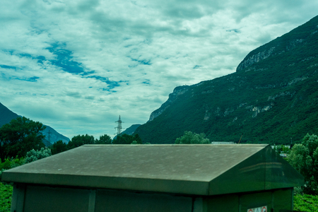 Europe, Italy, La Spezia to Kasltelruth train, a building with a mountain in the background 写真素材