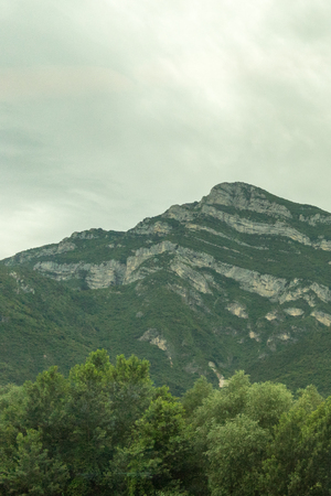 Europe, Italy, La Spezia to Kasltelruth train, a tree with a mountain in the background