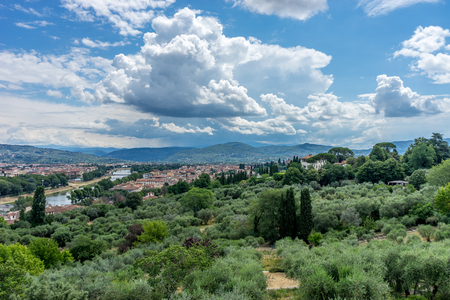 Europe, Italy, Florence, a large green field with trees in the background