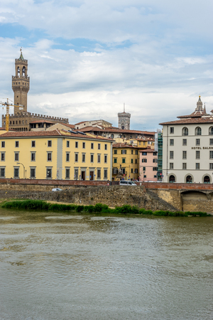 Florence, Italy - 25 June 2018: The Palazzo Vecchio over the Arno River in Florence, Italy