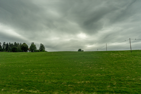 Europe, Italy, La Spezia to Kasltelruth train, a large green field with clouds in the sky 写真素材