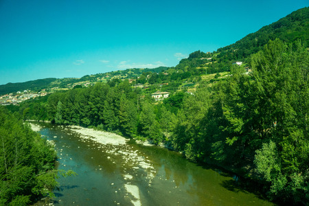Italy, a small water creek in the forest 스톡 콘텐츠