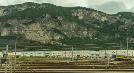 Italy - 28 June 2018: The yellow Plasser and Theurer on Trenitalia in the italian outskirts track