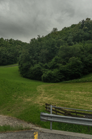 Europe, Italy, La Spezia to Kasltelruth train, an empty park bench sitting in the grass 写真素材