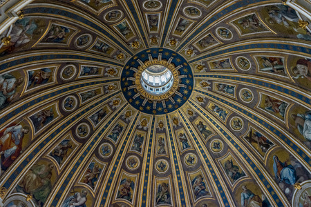 Vatican City, Italy - 23 June 2018: Decoration on the ceiling dome of Saint Peter's Basilica at St. Peter's Square in Vatican City