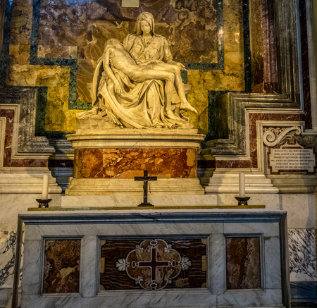 Vatican City, Italy - 23 June 2018: La Pieta (The Pity) 1499 Renaissance sculpture by Michelangelo Buonarroti, inside St. Peters Basilica in Vatican City