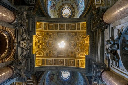Vatican City, Italy - 23 June 2018: Decoration on the ceiling dome of Saint Peters Basilica at St. Peters Square in Vatican City Redakční