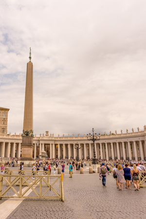 Vatican City, Italy - 23 June 2018: the Obelisk and Colonnades at St. Peters Square with water fountain in Vatican City