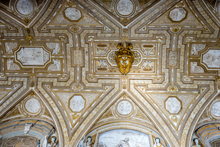 Vatican City, Italy - 23 June 2018: Decoration on the ceiling of Saint Peters Basilica at St. Peters Square in Vatican City