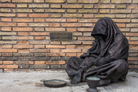 Rome, Italy - 23 june 2018: The bronze statue of the Homeless Jesus by sculptor Timothy Schmalz in Rome, Italy Editorial