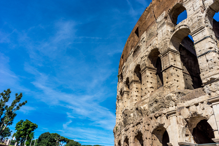 Facade of the Great Roman Colosseum (Coliseum, Colosseo), also known as the Flavian Amphitheatre. Famous world landmark