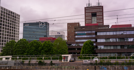 Den Haag, 22 June 2018: The post NL and Siemens building viewed from Den Haag central railway station