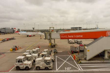 Amsterdam, Schiphol - 22 June 2018: Austrian airline plane and ING bank advertisement at the Schiphol airport