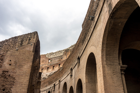 Rome, Italy - 23 June 2018: Interior of the Roman Colosseum (Coliseum, Colosseo), also known as the Flavian Amphitheatre. Famous world landmark. Scenic urban landscape. Редакционное