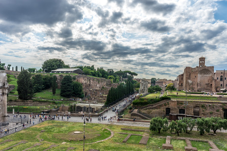 Rome, Italy - 23 June 2018: The ancient ruins at the Roman Forum of Temple of Venus and Roma at Rome viewed from the colosseum. Famous world landmark. Scenic urban landscape. Redactioneel