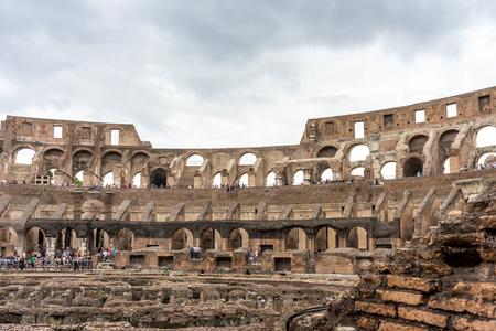 Rome, Italy - 23 June 2018: Interior of the Roman Colosseum (Coliseum, Colosseo), also known as the Flavian Amphitheatre. Famous world landmark. Scenic urban landscape. 新闻类图片
