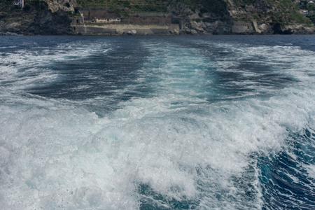 Europe, Italy, Cinque Terre, Monterosso, a man riding a wave on top of a body of water