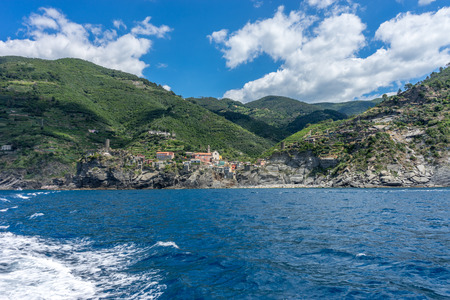 Europe, Italy, Cinque Terre, Monterosso, a large body of water with a mountain in the background Reklamní fotografie - 121041389