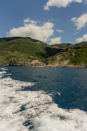 Europe, Italy, Cinque Terre, Monterosso, a body of water with a mountain in the background