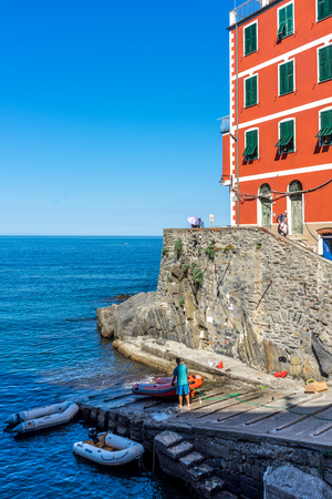 Riomaggiore, Cinque Terre, Italy - 27 June 2018: The cityscape townscape of Riomaggiore viewed from the sea