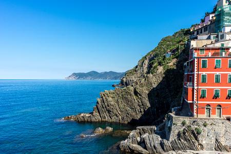 Italy,Cinque Terre,Riomaggiore, The cityscape townscape  viewed from the sea Reklamní fotografie - 121050674