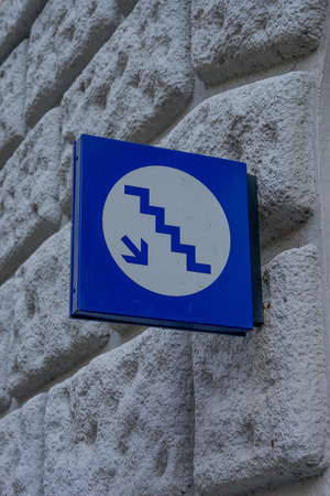 Italy,Cinque Terre,Riomaggiore, a sign on the side of a building pointing towards stairs 스톡 콘텐츠