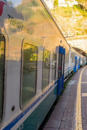 Riomaggiore, Cinque Terre, Italy - 26 June 2018: The Trenitalia train at Riomaggiore railway station, Cinque Terre, Italy Editorial
