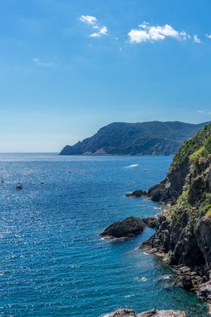 Europe, Italy, Cinque Terre, Vernazza, a body of water with a mountain in the background