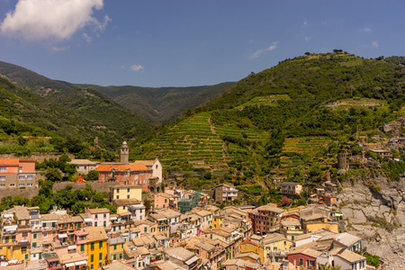 Europe, Italy, Cinque Terre, Vernazza, Vernazza, HIGH ANGLE VIEW OF TOWNSCAPE AND MOUNTAINS AGAINST SKY